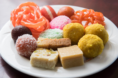 DAVID LIPNOWSKI / WINNIPEG FREE PRESS  Laddu (yellow balls), jalebi (orange) and barfi (squares) and Gulab jamun (balls).  Punjab Sweet House, 88 Mandalay Drive. Photographed Saturday May 21, 2016 for Bart Kives review.