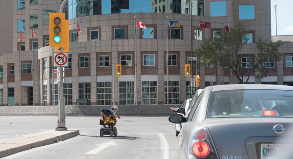 DAVID LIPNOWSKI / WINNIPEG FREE PRESS  Confused person blocking traffic to Portage & Main Saturday May 21, 2016.