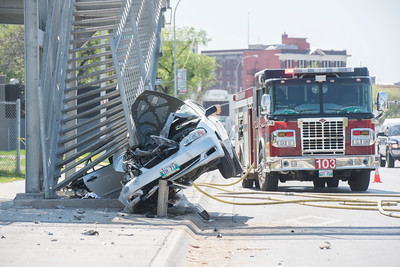 DAVID LIPNOWSKI / WINNIPEG FREE PRESS  Scene of motor vehicle accident (MVA) at the on ramp of the Disraeli Bridge Saturday May 21, 2016.