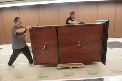 DAVID LIPNOWSKI / WINNIPEG FREE PRESS  (L-R) Rick Schwenzer and Eric Dienstbier of Winnipeg small moving specialists move office equipment from the Council building to the Administration building through the underground tunnel Wednesday May 25, 2016 while the Council building undergoes renovations .