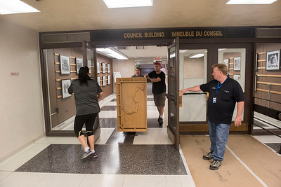 DAVID LIPNOWSKI / WINNIPEG FREE PRESS  Holly Schwenzer (left) and Wayne Burch of the city of Winnipeg hold the doors open for Rick Schwenzer and Eric Dienstbier of Winnipeg small moving specialists as they move office equipment from the Council building to the Administration building through the underground tunnel Wednesday May 25, 2016 while the Council building undergoes renovations .