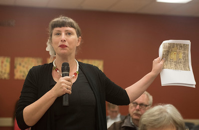 DAVID LIPNOWSKI / WINNIPEG FREE PRESS  Local River Heights resident Abigail Mickelthwate voices her concerns about a proposed cell phone tower in her area with The Hon. Jim Carr, MP for Winnipeg South Centre and Minister of Natural Resources during a quarterly town hall at the Asper Jewish Community Campus Wednesday May 25, 2016. One such issue discussed was the proposed cell tower at the corner of  Niagara St and Grosvenor Ave (there is currently an MTS switching station that looks like a residential property there).