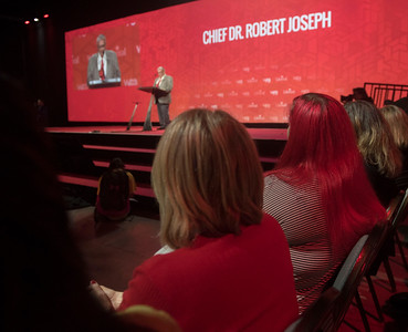 DAVID LIPNOWSKI / WINNIPEG FREE PRESS  The audience sporting red clothing and hair in this case watch the key note by Chief Dr. Robert Joseph during the opening of the 2016 Liberal Biennial Convention at RBC Convention Centre Thursday May 25, 2016.