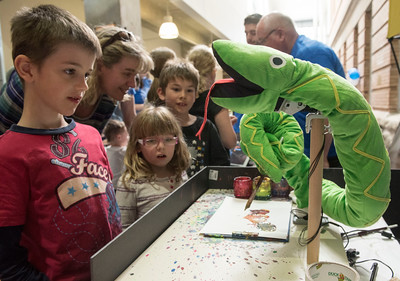 DAVID LIPNOWSKI / WINNIPEG FREE PRESS  Connor watches as a robot named Picassnake paints to the sound of music during Science Rendezvous in the Engineering Atrium at the University of Manitoba Saturday, May 7, 2016.