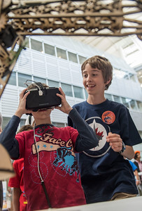 DAVID LIPNOWSKI / WINNIPEG FREE PRESS  Brothers Connor (left) and Kaden try out a virtual reality headset during Science Rendezvous in the Engineering Atrium at the University of Manitoba Saturday, May 7, 2016.