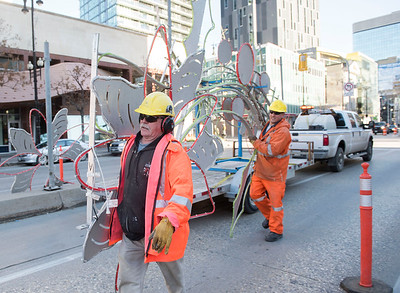 DAVID LIPNOWSKI / WINNIPEG FREE PRESS   City of Winnipeg Utility Workers Herb (left) and Mike (right) carry festive lights being installed on Portage Avenue Saturday November 5, 2016 on an unseasonably warm fall day.