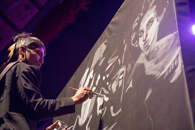 DAVID LIPNOWSKI / WINNIPEG FREE PRESS   Artist Nereo Eugenio II paints as the Winnipeg Symphony Orchestra performs Symphonie Fantastique on Tuesday, October 18, 2016 at the Centennial Concert Hall.