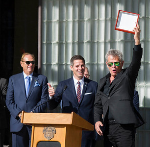 DAVID LIPNOWSKI / WINNIPEG FREE PRESS  David Foster receives (and accidentally drops) Winnipeg's highest honour, the key to the City from Mayor Bowman Friday September 23, 2016 at City Hall.  A Transplant Manitoba flag was also raised to promote the importance of organ donation in Manitoba.