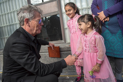 DAVID LIPNOWSKI / WINNIPEG FREE PRESS  David Foster meets liver transplant (and liver cell transplant) recipient Nazdana Jan (age 4 right), and her sister Paghunda (age 6, center) following a presentation of Winnipeg's highest honour, the key to the City to David Foster from Mayor Bowman Friday September 23, 2016 at City Hall.  A Transplant Manitoba flag was also raised to promote the importance of organ donation in Manitoba.