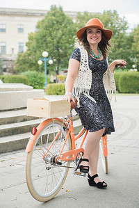 DAVID LIPNOWSKI / WINNIPEG FREE PRESS  Producer of the Cyclovia fashion show Lili Lavack poses for photos on Assiniboine Avenue Styled by Alexis Karsniki Saturday September 3, 2016.  For 49.8 Threads story on upcoming Cyclovia fashion show
