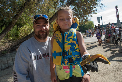 DAVID LIPNOWSKI / WINNIPEG FREE PRESS  Maggie (age 5) and dad Ryan Wait with a 18 cm Catfish, the first Catfish Maggie has ever caught. Hundreds of people registered to be part of a shoreline fall fishing derby along the Assiniboine River at the Forks in support of Marymound School and the Never Alone Foundation Saturday September 3, 2016.