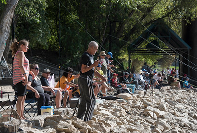 DAVID LIPNOWSKI / WINNIPEG FREE PRESS  Hundreds of people registered to be part of a shoreline fall fishing derby along the Assiniboine River at the Forks in support of Marymound School and the Never Alone Foundation Saturday September 3, 2016.