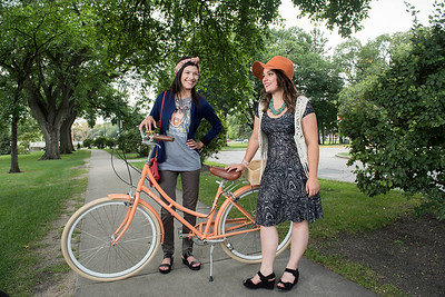 DAVID LIPNOWSKI / WINNIPEG FREE PRESS  Choreographer Carly Van Ryssel (left) and Producer of the Cyclovia fashion show Lili Lavack (right) pose for photos on Assiniboine Avenue Styled by Alexis Karsniki Saturday September 3, 2016.  For 49.8 Threads story on upcoming Cyclovia fashion show