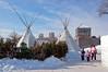 Native teepees set up outside Fort Gibralter at the Festival du Voyageur winter festival in St. Boniface, Winnipeg, Manitoba, Canada.