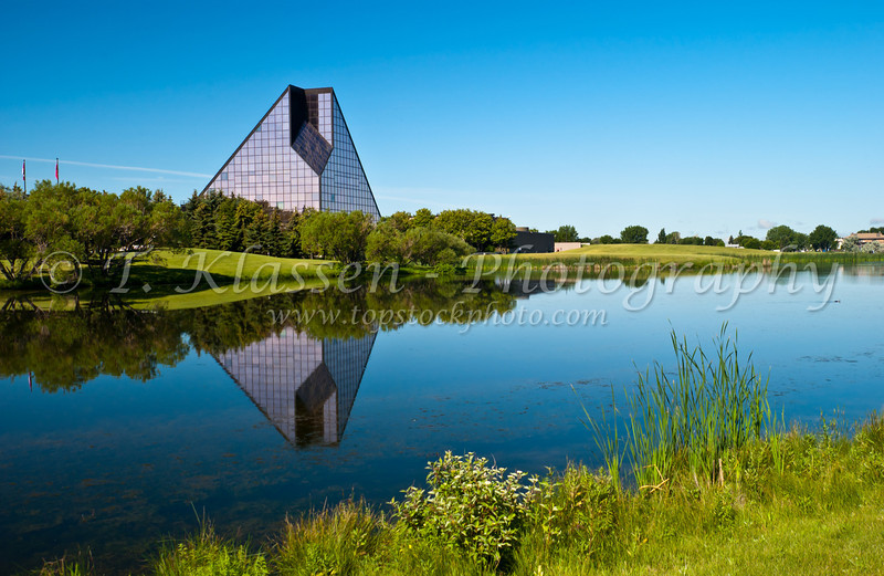 The Royal Canadian Mint building with reflection in the pond in Winnipeg, Manitoba, Canada.