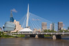 The Red River, Provencher Bridge and city skyline of Winnipeg, Manitoba, Canada.