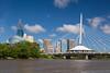 The Red River, Provencher Bridge and city skyline of Winnipeg, Manitoba, Canada.