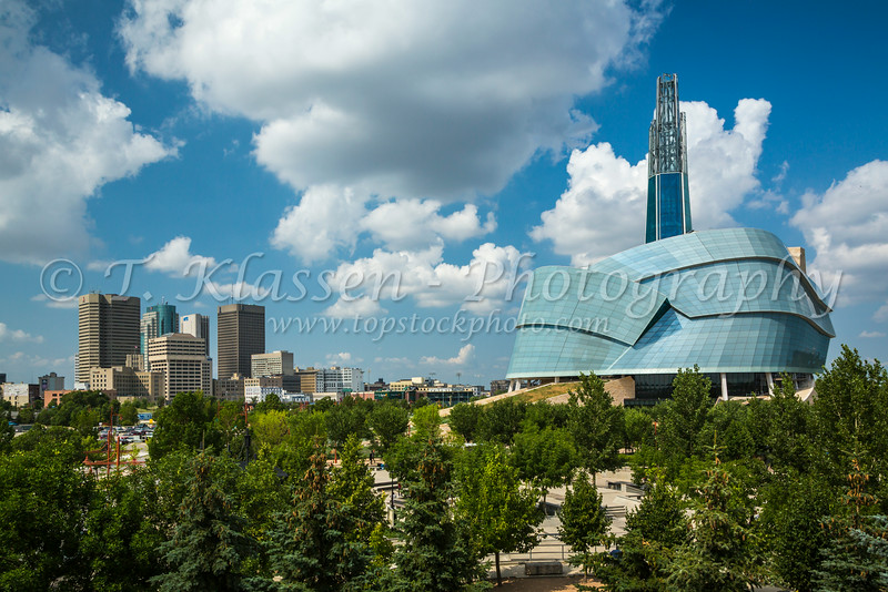 The Canadian Museum of Human Rights at The Forks and the city skyline in Winnipeg, Manitoba, Canada.