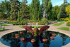 A decorative pool with dolphin sculptures in the English Gardens in Assiniboine Park in Winnipeg, Manitoba, Canada.
