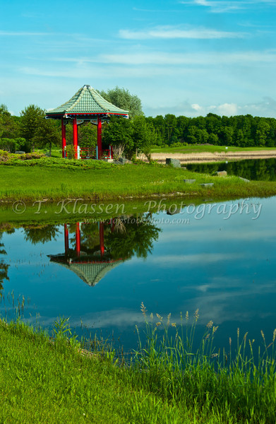 Calm waters on the lake reflect the Chinese pagoda at Kings Park in Fort Garry, Winnipeg, Manitoba, Canada.