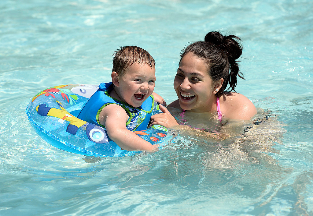 . Jovani Baeza, 23 months, smiles as he floats in the water with his mom, Johana Silva, Tuesday, May 30, 2017, at Winona Pool in Loveland. The pool opened on Memorial Day for the summer.  (Photo by Jenny Sparks/Loveland Reporter-Herald)