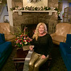 Solid gold: Sipping a little bubbly in front of the cozy fire at the Vesper and surrounded by gorgeous flowers, I'm wearing gold, boot-cut pleather pants and a black fuzzy sweater with gold sequins. Don't forget to change your clocks ahead!