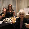 Andiamo's Kerri Dupuis of Chelmsford, left, and manager Emily Tashchereau of Methuen serve  Catherine O'Donnell their concoction, which tied for second place.