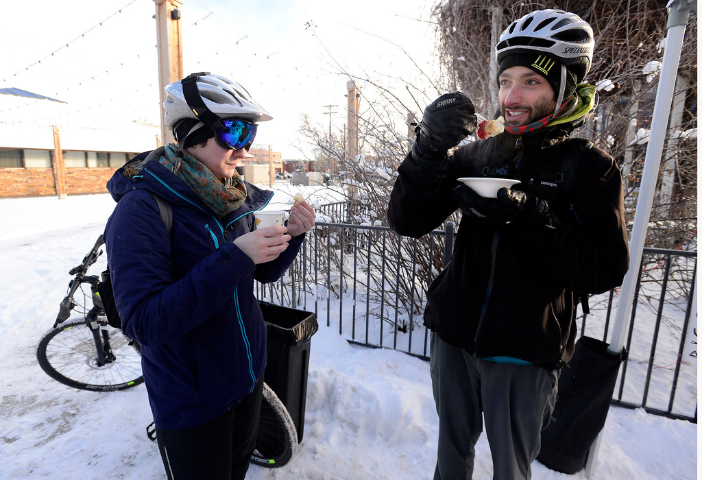 . BOULDER, CO - FEBRUARY 8, 2019 Althea Koburger and Michael Green finish a hot breakfast outside the Boulder Dushanbe Teahouse during Winter Bike to Work Day on Friday February 8 2019. They were both heading to work on their bikes.  For more photos go to dailycamera.com (Photo by Paul Aiken/Staff Photographer)