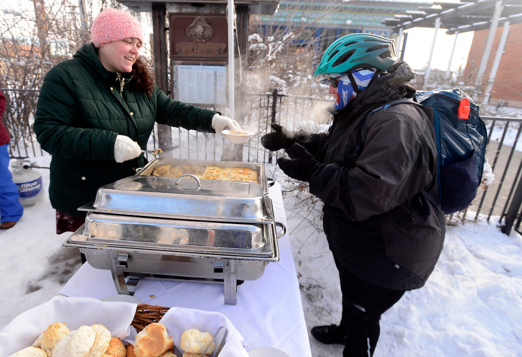 . BOULDER, CO - FEBRUARY 8, 2019 Claire Benton gets served a free breakfast served by teahouse manager Jill King outside the Boulder Dushanbe Teahouse during Winter Bike to Work Day on Friday February 8 2019. Benton was biking to work. For more photos go to dailycamera.com (Photo by Paul Aiken/Staff Photographer)