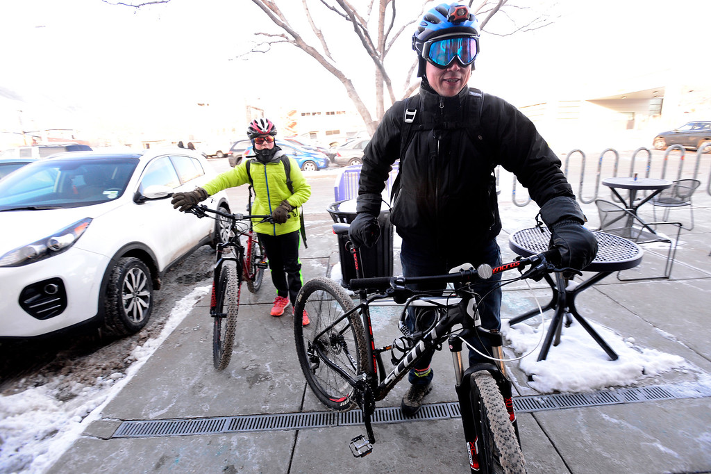 . BOULDER, CO - FEBRUARY 8, 2019 Garvin Heath and his son Aden head into Moe\'s Bagels for a free bagel during Winter Bike to Work Day on Friday February 8 2019. For more photos go to dailycamera.com (Photo by Paul Aiken/Staff Photographer)
