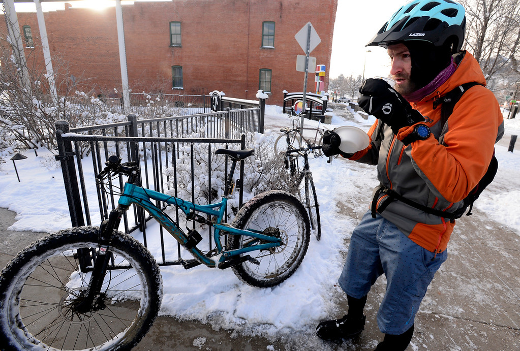 . BOULDER, CO - FEBRUARY 8, 2019 Liam Donoghue finishes a free hot breakfast  outside the Boulder Dushanbe Teahouse after he finished the first 3 hour part of his ride from Gilpin County to Boulder during Winter Bike to Work Day on Friday February 8 2019. Donoghue had another hour on his ride which he does in the summer but made a special winter trip for bike to work day.  For more photos go to dailycamera.com (Photo by Paul Aiken/Staff Photographer)