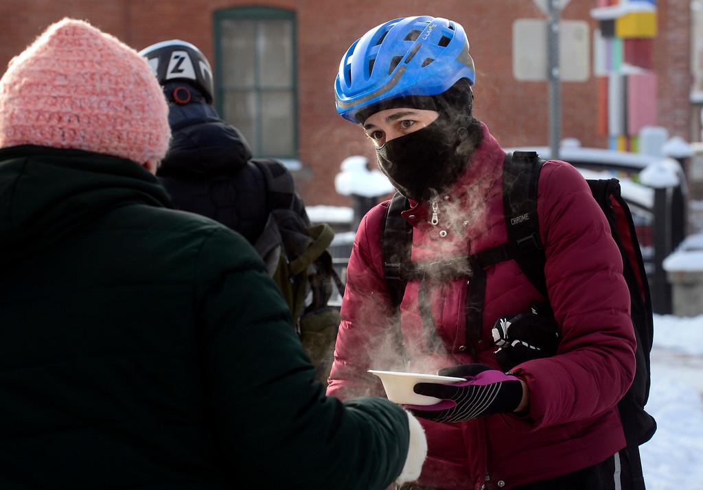 . BOULDER, CO - FEBRUARY 8, 2019 Denee Janda gets a hot breakfast being served by Jill King outside the Boulder Dushanbe Teahouse during Winter Bike to Work Day on Friday February 8 2019.  Janda was biking to her job at the University of Colorado. King is the manager of the teahouse.  For more photos go to dailycamera.com (Photo by Paul Aiken/Staff Photographer)