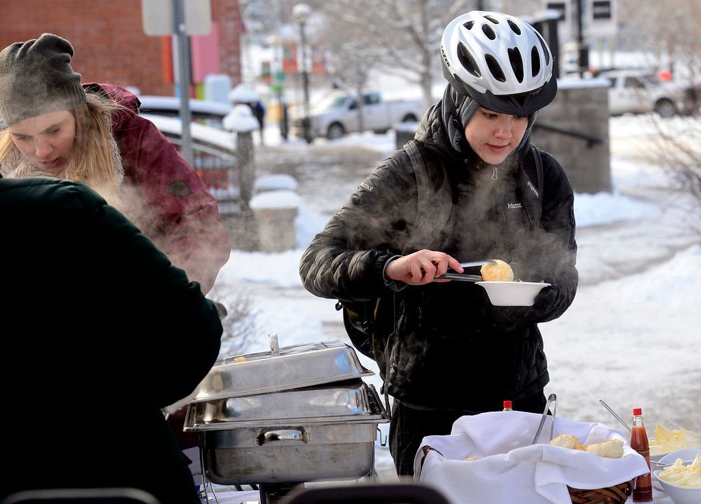 . BOULDER, CO - FEBRUARY 8, 2019 Rey Cronin gets a hot breakfast being served by Jill King outside the Boulder Dushanbe Teahouse during Winter Bike to Work Day on Friday February 8 2019.  Cronin was biking to her studies at the University of Colorado. King is the manager of the teahouse.  For more photos go to dailycamera.com (Photo by Paul Aiken/Staff Photographer)