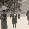 Woman walking through snow with bangasa (paper umbrella).