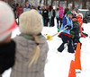 HOLLY PELCZYNSKI - BENNINGTON BANNER Lilli Favor, third grader at Manchester Elementary School pulls with all her might during a game of tug of war during a winter carnival at Mems on Wednesday morning in Manchester.