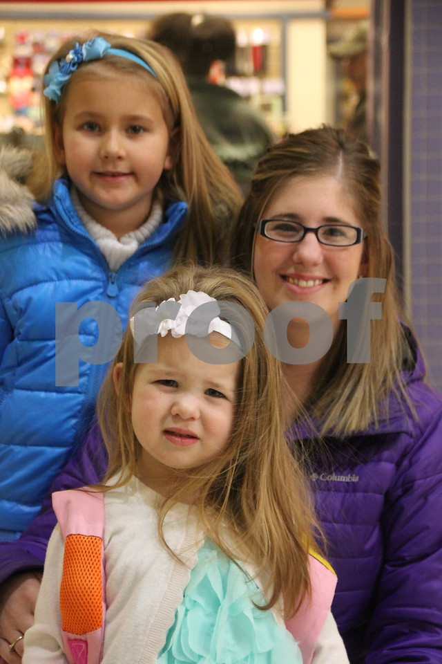 The Winter Craft and Vendor Show took place at Crossroads Mall in Fort Dodge on Saturday, December 19, 2015. Seen here is : Back row: WIllow Godfrey, Middle row: Alisa Godfrey (mother), and Front row: Hadlee Godfrey. They were enjoying the many vendor's items available.