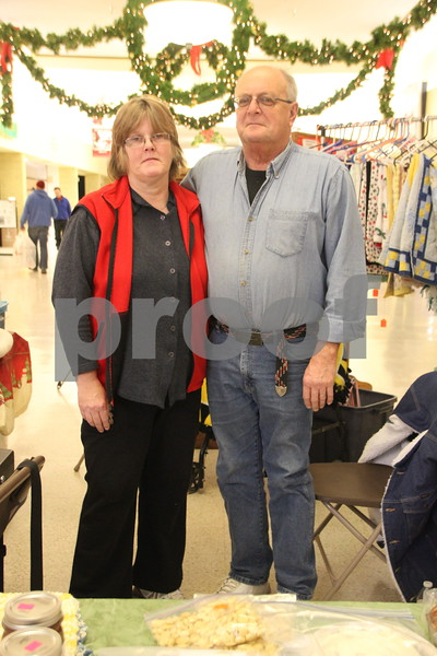 Crossroads Mall in Fort Dodge, was the place to be if you enjoy  crafts and vendor shows. The Winter Craft and Vendor Show took place there on Saturday, December 19,2015. One of the vendors taking part in the event is shown here. Pictured is (left to right) : Karolyn Snedeker, and Frank Popp.