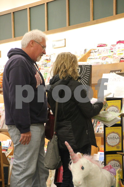 The Winter Craft and Vendor Show took place at Crossroads Mall in Fort Dodge on Saturday, December 19, 2015. Pictured (left to  right) here is : Ron Grebner and Maria Conell as they look over some books on display at the book store.
