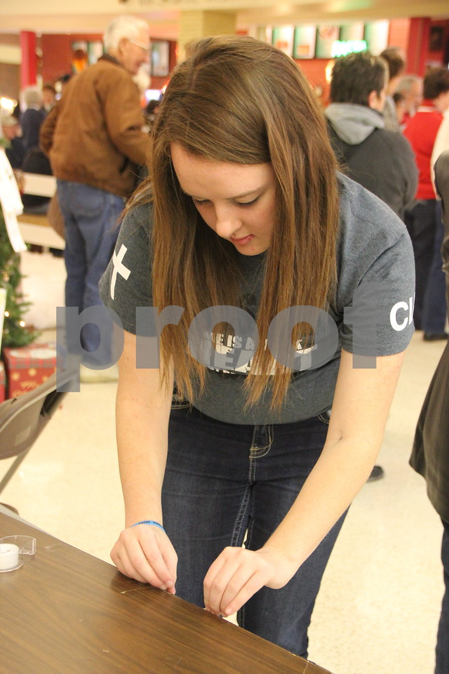 Crossroads Mall in Fort Dodge, was the place to be if you enjoy crafts and vendor shows. The Winter Craft and Vendor Show took place there on Saturday, December 19,2015. Seen is : Amber Harrison from the Good Shepherd C.I.A. Youth Group, one of many vendors taking part in the event.