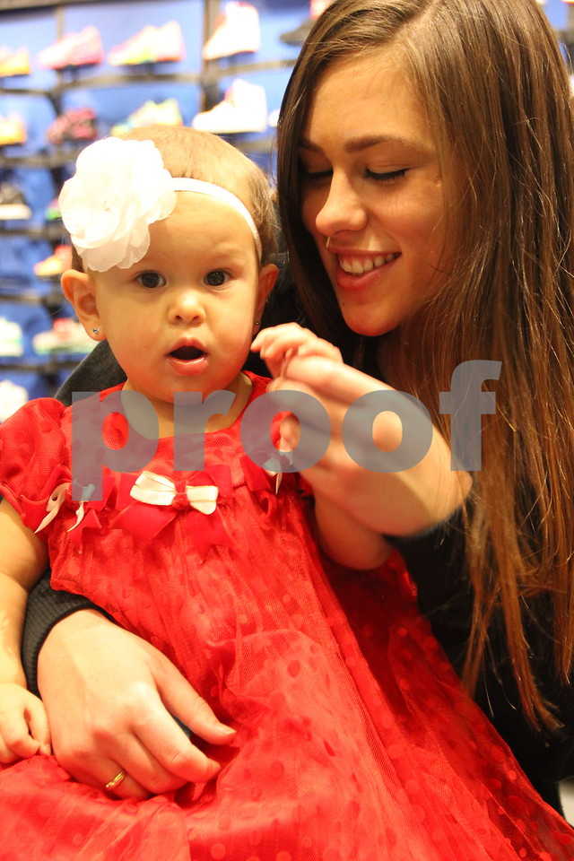 Pictured (left to right) here is : Rellah Lopez, and Taylor Tesch,  taking in some of the items in stores at the Winter Craft and Vendor Show that took place at Crossroads Mall in Fort Dodge on Saturday, December 19, 2015.