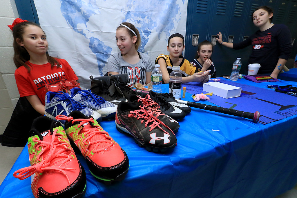 . From left is Anna Serafini, 12, Victoria Witzgall, 11, Devyn Booth, 11, Lauren McMahon, 12, and Patience Roberge, 12, had a table to raising money for students that wanted to play sports but could not afford to by the stuff need to play during the Winter Fest at Sky View Middle School on Saturday, January 26, 2019. SENTINEL & ENTERPRISE/JOHN LOVE