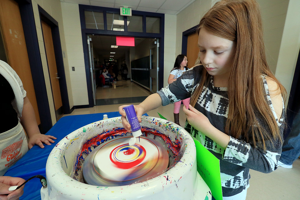 . Samantha Person, 9, makes some spin art during the Winter Fest at Sky View Middle School on Saturday, January 26, 2019. SENTINEL & ENTERPRISE/JOHN LOVE