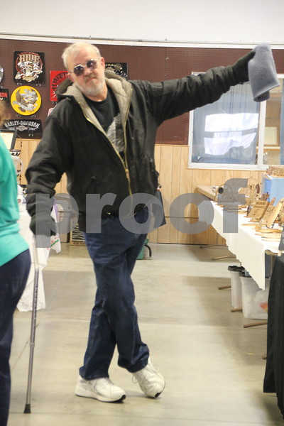 Saturday, January 9, 2016 the Webster County Fairgrounds in Fort Dodge held the Winter Flea Market. The event will go through Sunday, January 10, 2016 . Gene Van Grevenhof is seen here having some fun as he poses for this picture.