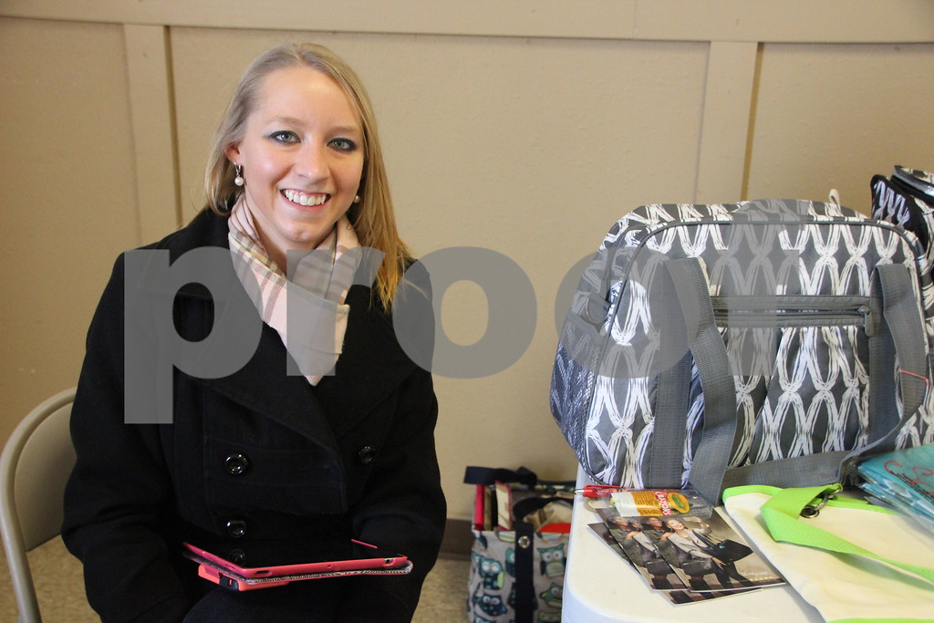 Saturday, January 9, 2016 the Webster County Fairgrounds in Fort Dodge held the Winter Flea Market. The event will go through Sunday, January 10, 2016 . Pictured here is: Amanda Hancock, another vendor at the event.
