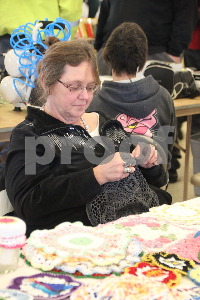 Saturday, January 9, 2016 the Webster County Fairgrounds in Fort Dodge held the Winter Flea Market. The event will go through Sunday, January 10, 2016 . Seen here is: Debbie Henrikson-Houser , another vendor at the event, as she crochets another item similar to those she sells.