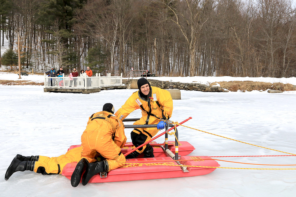. The Leominster Recreation Department, Project Apples, Growing Places, Leominster Trail Stewards, Emergency Management, the Fire Department and the Boy Scouts joined together to offer a free winter event on Saturday, February, 23, 2019 at Barrett Park. During the event the Leominster Fire Department with Emergency Management held an ice saftey and ice rescue demonstration on Colburns Reservoir at the park. Firefighter Jon Williams, on right, and Firefighter Jeremy Murphy show how they rescue Firefighter Adam Studham from a hole in the ice. SENTINEL & ENTERPRISE/JOHN LOVE