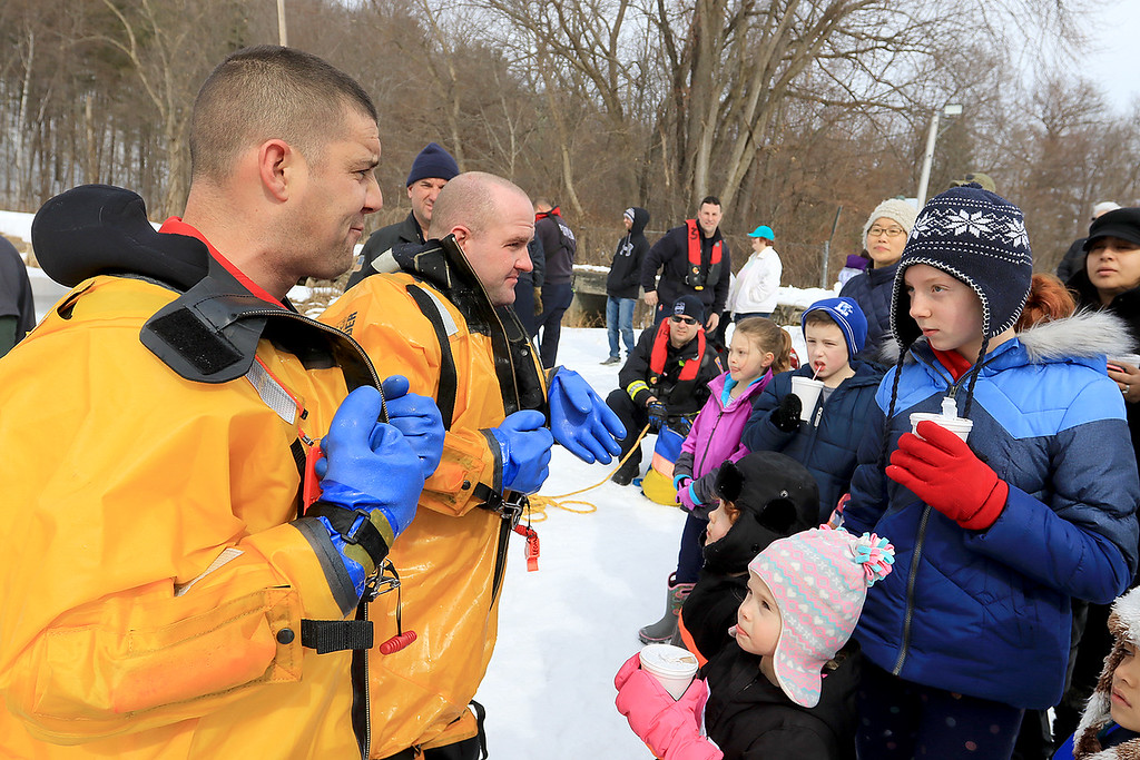 . The Leominster Recreation Department, Project Apples, Growing Places, Leominster Trail Stewards, Emergency Management, the Fire Department and the Boy Scouts joined together to offer a free winter event on Saturday, February, 23, 2019 at Barrett Park. During the event the Leominster Fire Department with Emergency Management held an ice saftey and ice rescue demonstration on Colburns Reservoir at the park. charlotte Ray, 11 in red gloves, of Streling chats with Firefighter Jon Williams after their ice rescue demonstration. With Williams is Firefighter Adam Studham. SENTINEL & ENTERPRISE/JOHN LOVE