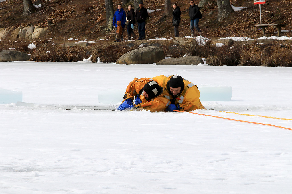 . The Leominster Recreation Department, Project Apples, Growing Places, Leominster Trail Stewards, Emergency Management, the Fire Department and the Boy Scouts joined together to offer a free winter event on Saturday, February, 23, 2019 at Barrett Park. During the event the Leominster Fire Department with Emergency Management held an ice saftey and ice rescue demonstration on Colburns Reservoir at the park. Firefighter Jeremy Murphy show hot to rescue Firefighter Adam Studham, on left, during the demonstration. SENTINEL & ENTERPRISE/JOHN LOVE