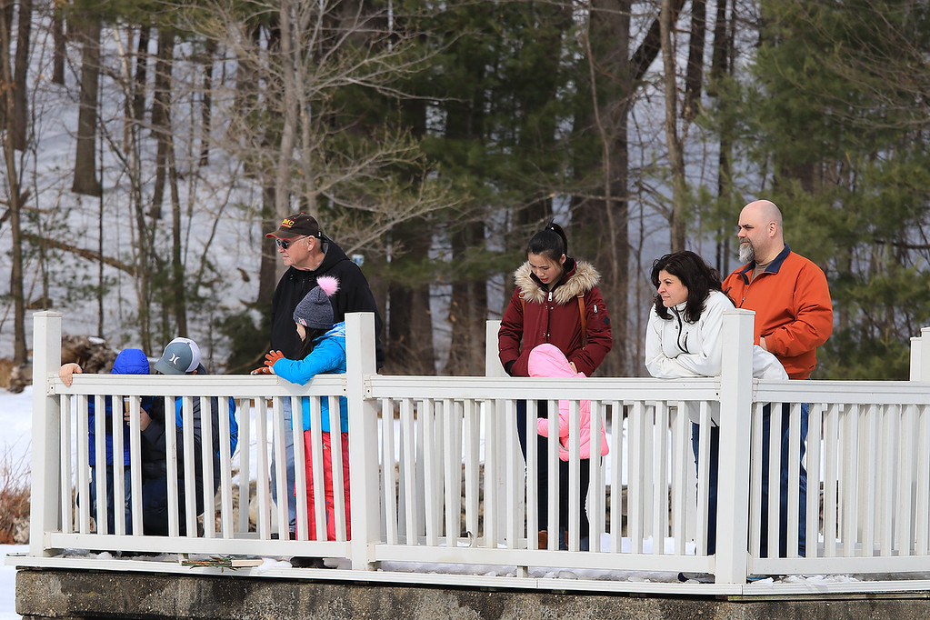. The Leominster Recreation Department, Project Apples, Growing Places, Leominster Trail Stewards, Emergency Management, the Fire Department and the Boy Scouts joined together to offer a free winter event on Saturday, February, 23, 2019 at Barrett Park. During the event the Leominster Fire Department with Emergency Management held an ice saftey and ice rescue demonstration on Colburns Reservoir at the park. people watch ther demonstration from the dock at the park. SENTINEL & ENTERPRISE/JOHN LOVE