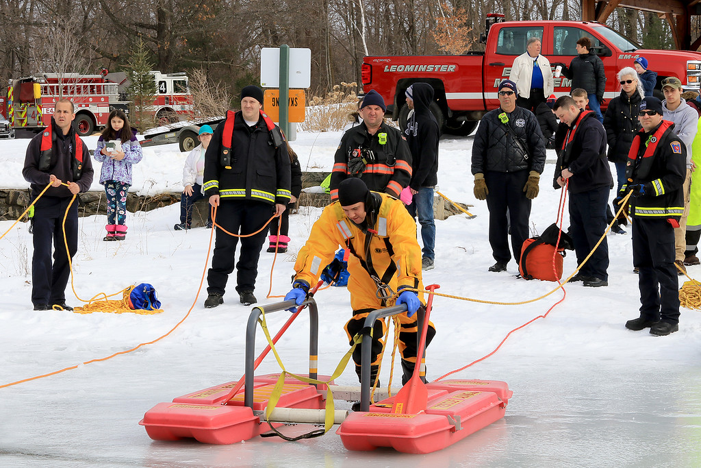 . The Leominster Recreation Department, Project Apples, Growing Places, Leominster Trail Stewards, Emergency Management, the Fire Department and the Boy Scouts joined together to offer a free winter event on Saturday, February, 23, 2019 at Barrett Park. During the event the Leominster Fire Department with Emergency Management held an ice saftey and ice rescue demonstration on Colburns Reservoir at the park. Firefighter Jon Williams heads on on the ice with their ice rescue sled during the demonstration. SENTINEL & ENTERPRISE/JOHN LOVE